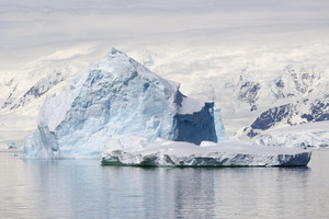 Towering iceberg and ice floe at dawn