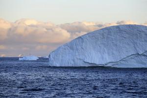 Towering icebergs at sunset