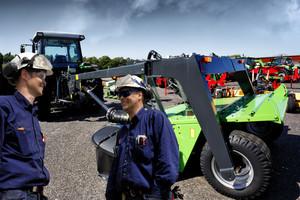 tractor mechanics in action