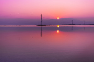 Transmission facilities in Dead Sea in Israel at sunset