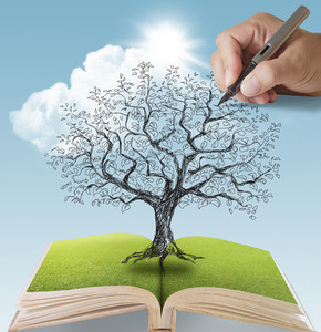 Tree Being Drawn Over Open Book