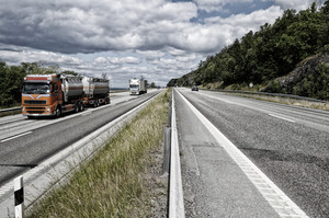 trucks and trafic on a busy highway, head on shot on trucks