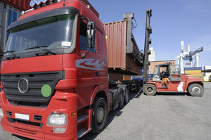trucks being unlioaded by forklifts