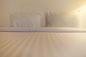 Twin white pillow on bed