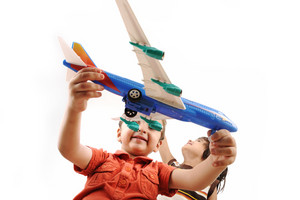 Two boys with airplanes in studio isolated