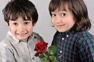 Two boys with beautiful red rose
