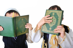 Two boys with holy Quran