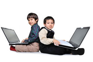 Two boys with laptops