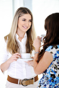 Two Business women enjoying a cup of coffee