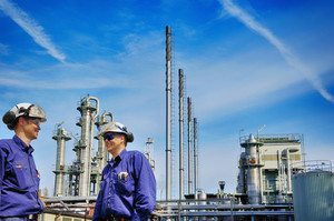 two chemical engineers inside refinery