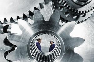 two engineers inside a gears axle
