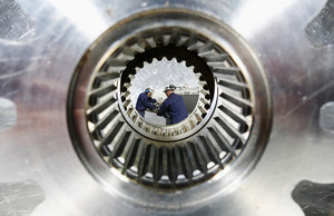 two engineers inside large cog axle