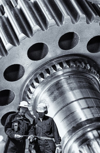 two engineers with cogs and gears machinery