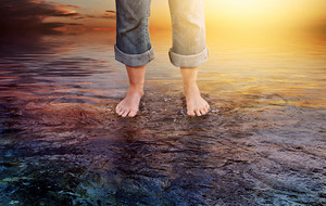 Two feet are firmly standing on water