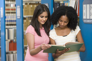 Two female students working together in library