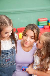 Two girls and teacher in  Kindergarten