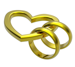 Two Gold Wedding Rings With Gold Heart.
