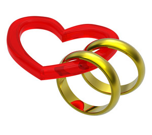 Two Gold Wedding Rings With Red Heart.