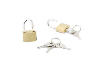 Two Golden Open Padlock With Keys On White