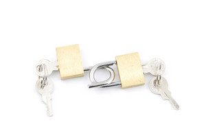 Two Golden Padlocks And Keys On White