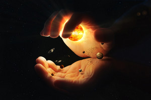 Two hands hold together the solar system