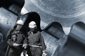 two industry workers with machine parts