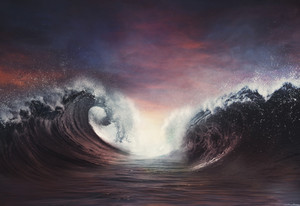 Two large waves parting in the ocean.