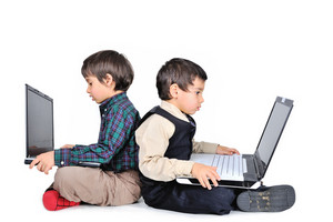Two little kids with laptops