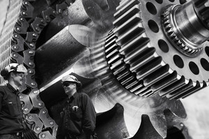 two mechanics with large cogs machinery