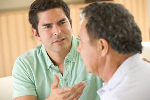 Two men in living room arguing