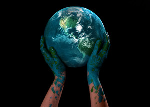 Two painted hands hold the earth. Elements provided by NASA.