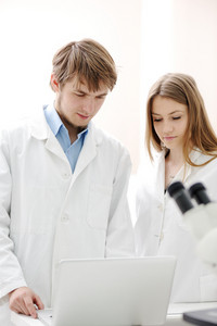 Two scientists working at the laboratory