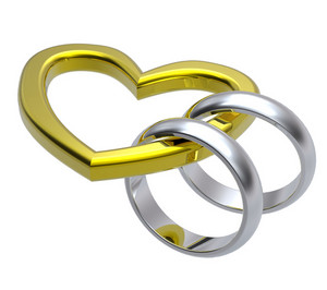 Two Silver Wedding Rings With Gold Heart.