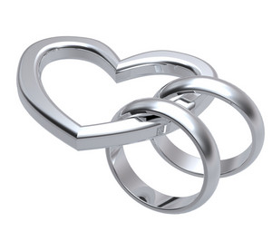 Two Silver Wedding Rings With Silver Heart.
