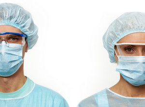 Two surgeons in masks isolated on white
