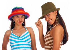 Two Teenage Girls Posing In Hats