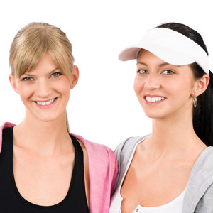 Two women friends sport outfit smiling isolated portrait