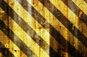 Under Construction Strips On Wooden Background