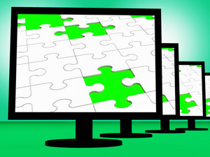 Unfinished Puzzle On Monitors Shows Missing Pieces