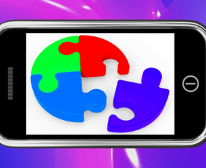 Unfinished Puzzle On Smartphone Showing Teamwork