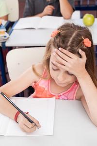 upset girl writing
