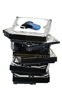Usb Flash Drive Liying On Top Of The Hard Drive