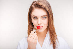 using lipstick on half of lips