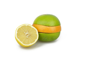Variety Of Citrus Fruit Slices On White Background