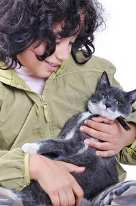 Very cute child with a cat in arms