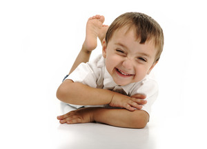 Very cute positive smiling little boy, isolated.