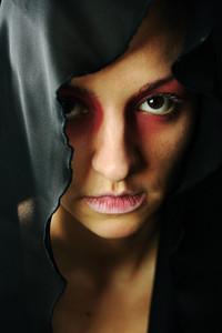 very pretty woman with dark  neckerchief on head, sensual sexuality gaze