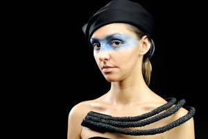Very pretty woman with dark  scarf, necklace, dress and colorful mask eyes, fashion stylish model