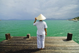 Vietnamese Woman in front of the sea