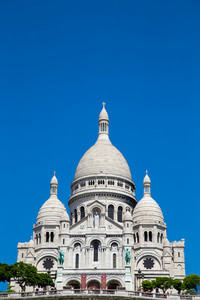 View of Basilica of the Sacred Heart of Paris with cloudy sky in background (Paris, France, Europe).